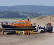 The Shannon lifeboat being transported on the SC Innovation Lifeboat Launch and Recovery System at Exmouth Beach